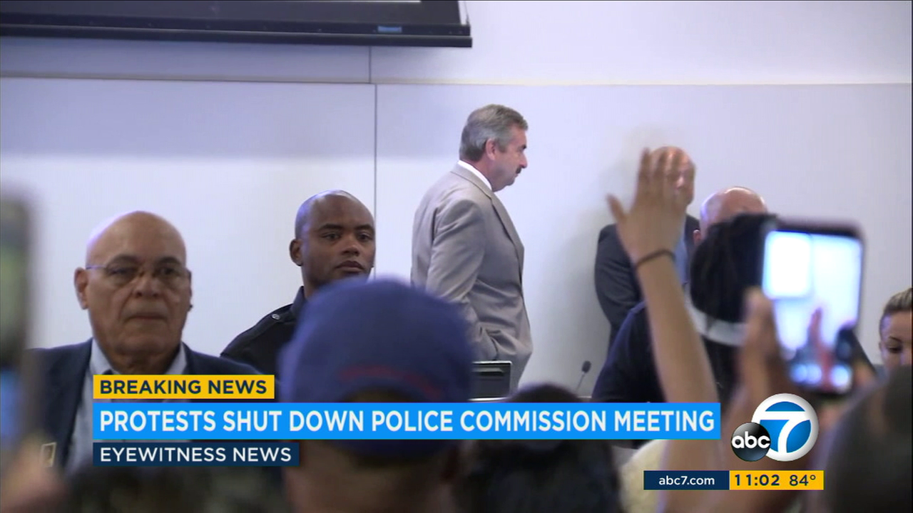 LAPD Chief Charlie Beck walks away as protesters shout at him during a police commission meeting on Tuesday, Aug. 8, 2017.