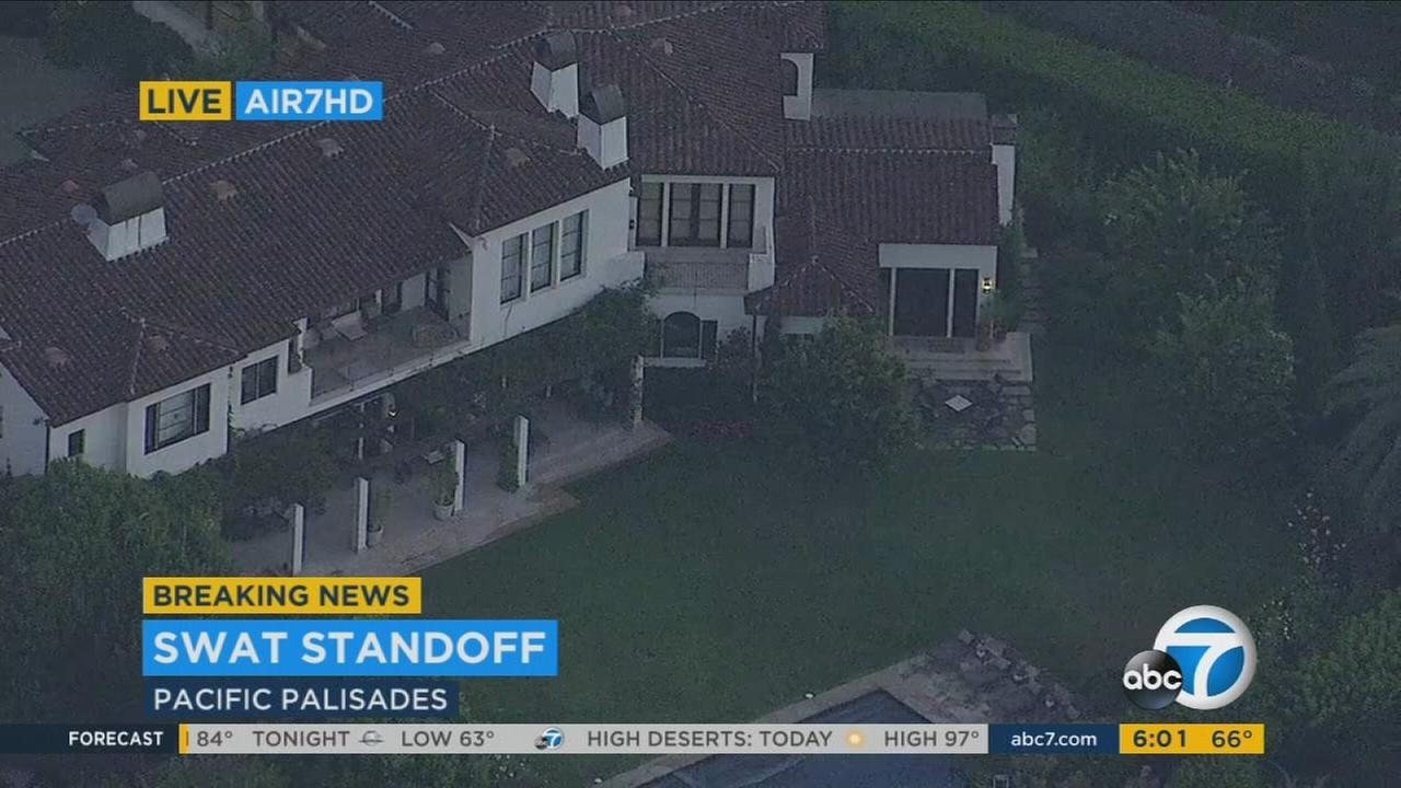 A barricaded man and Los Angeles Police Department officers were involved in a standoff at a home in Pacific Palisades on Thursday, Aug. 10, 2017.