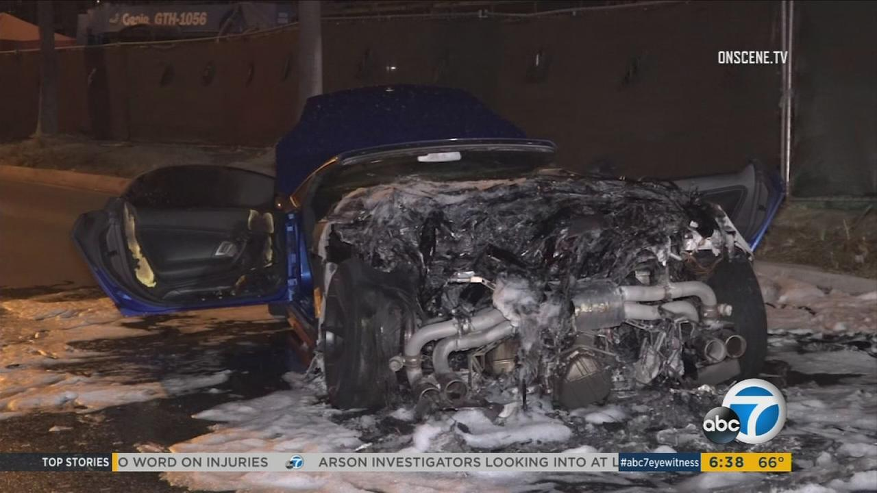 A totaled Lamborghini is shown after it burst into flames in Irvine.
