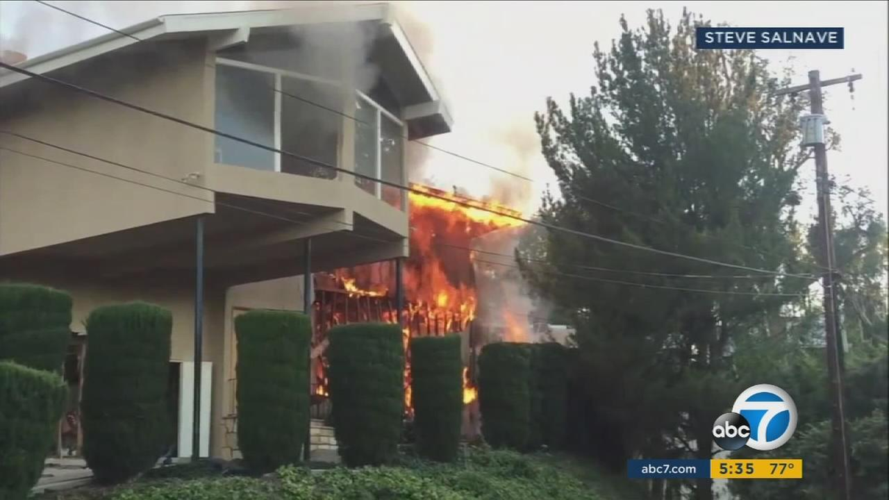 A Woodland Hills home erupted in flames after a contractor struck a gas line in the house.