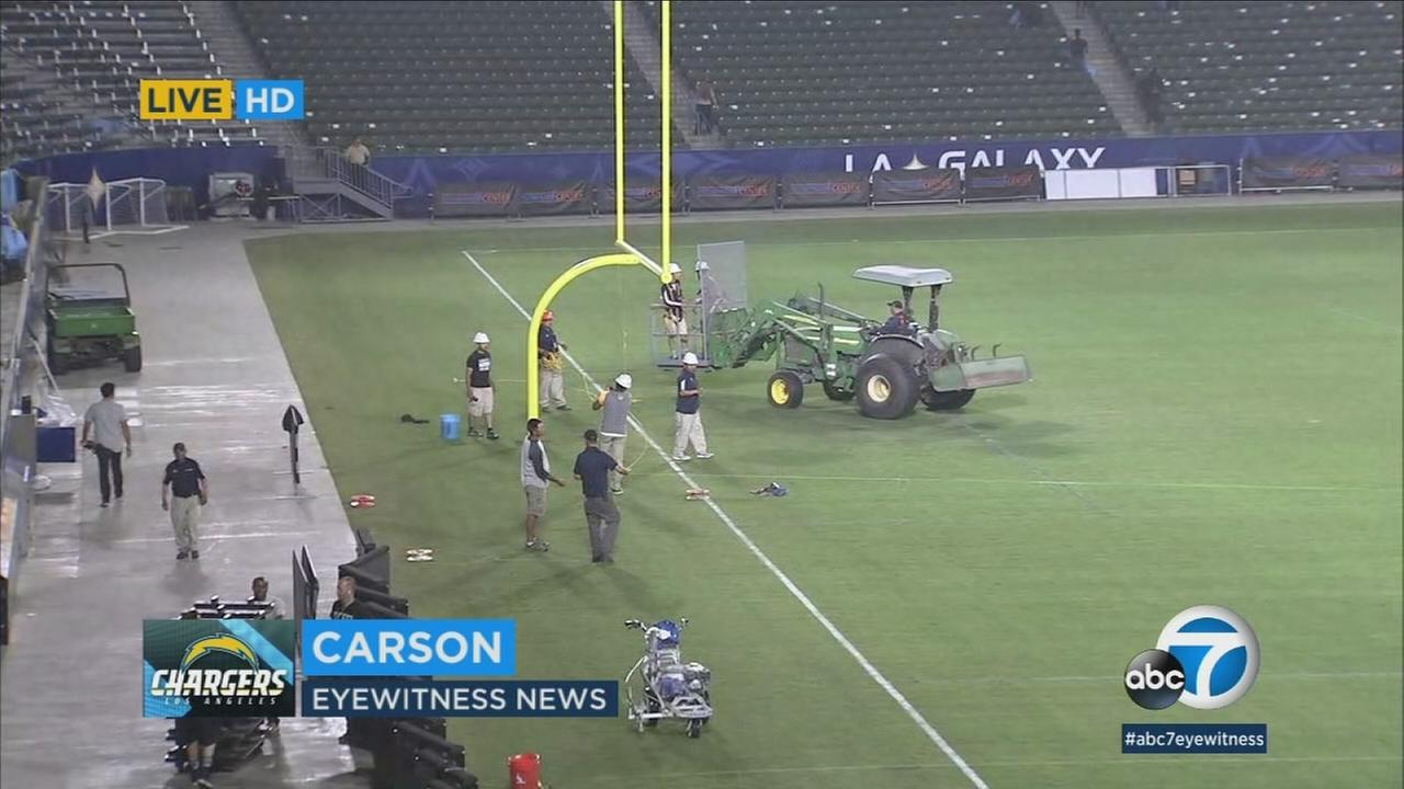 The Stub Hub Center is being transformed by crews to make room for the Chargers-Seahawks game.