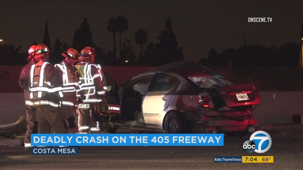 Emergency personnel respond to a fatal crash on the 405 Freeway in Costa Mesa.