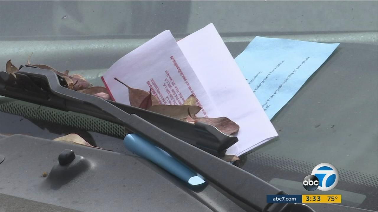A parking ticket is seen on a windshield in Los Angeles.