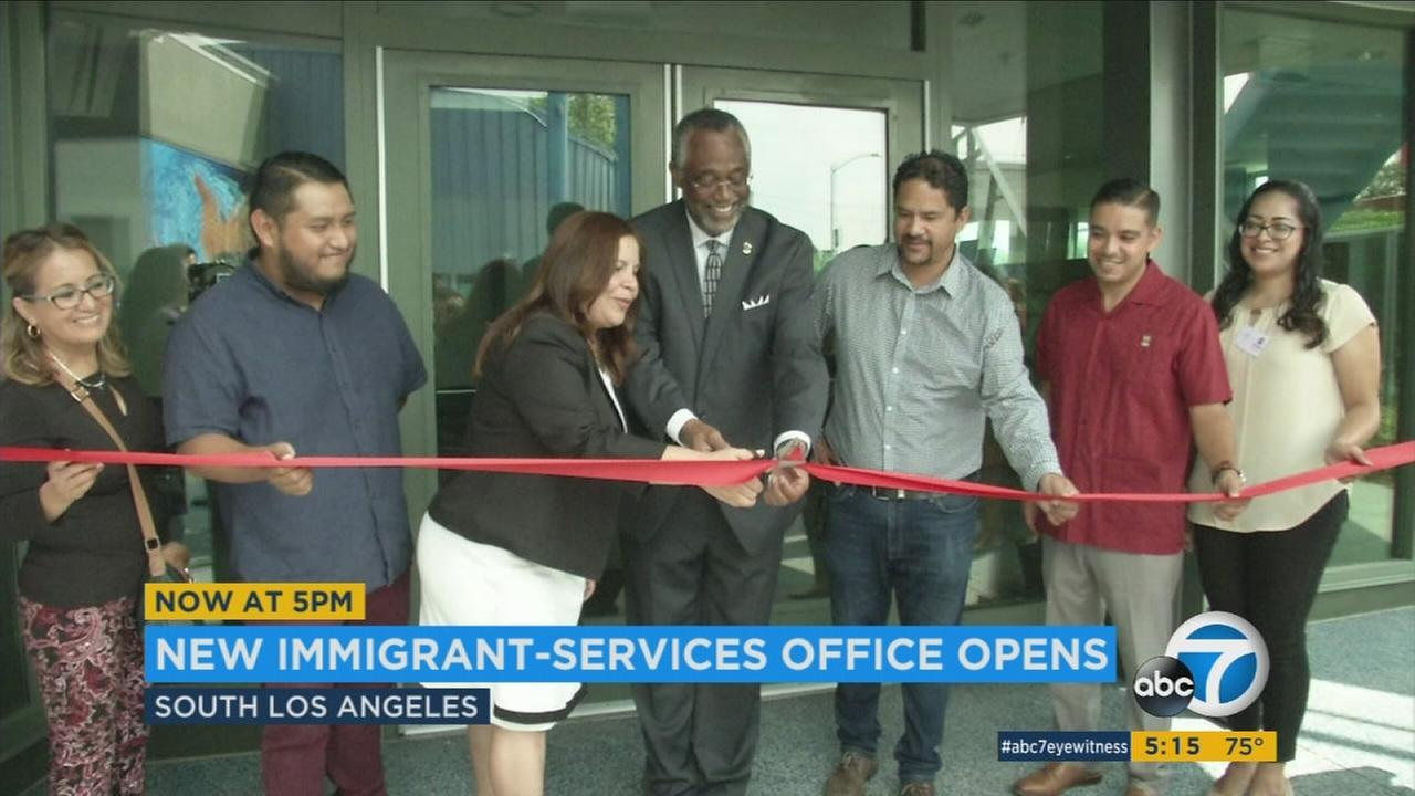 Officials cut a ceremonial ribbon at the opening of a new immigration services office in Sout Los Angeles on Wednesday, Aug. 17, 2017.