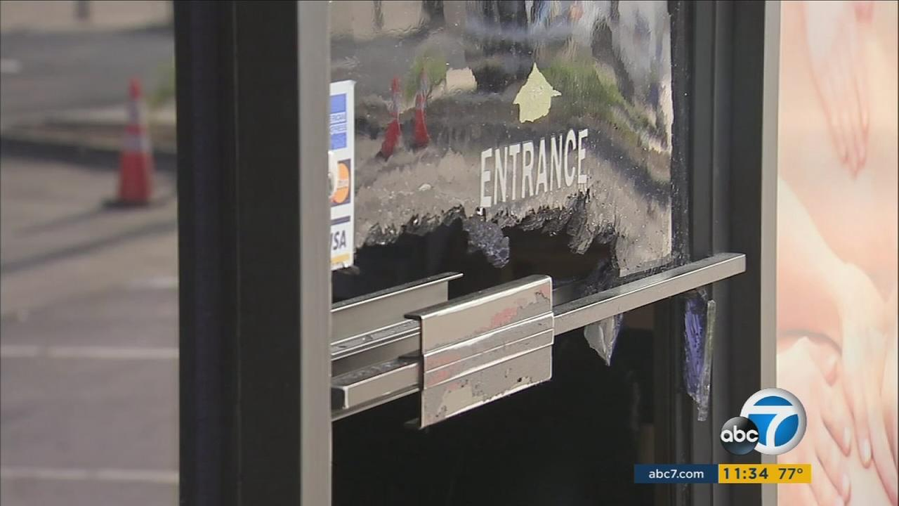 A glass door is seen shattered at a business in Diamond Bar following a break-in.