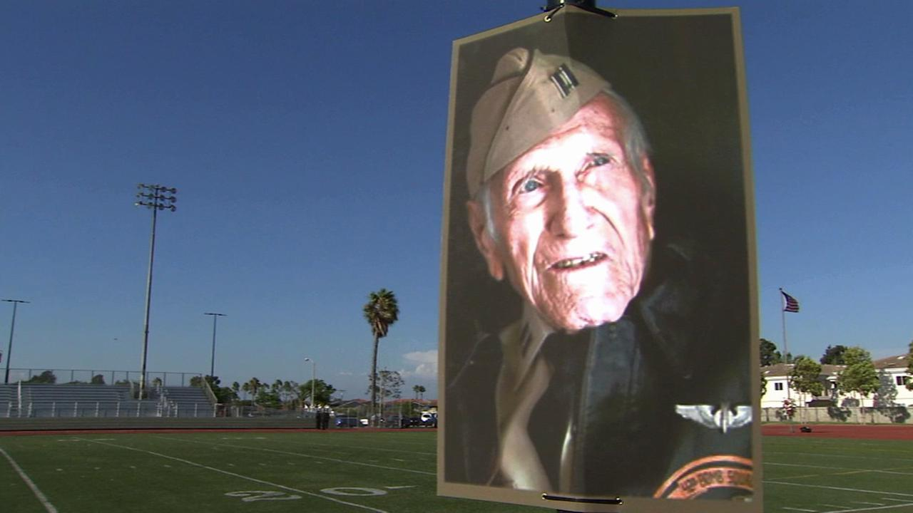 A photo of Louis Zamperini hangs at a memorial for the Olympian and WWII vet in Torrance on Thursday, July 31, 2014.