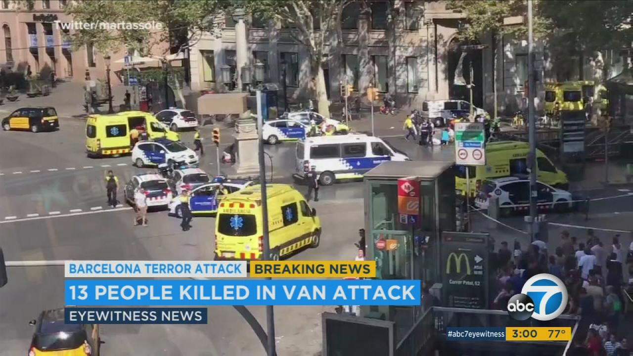 Two people have been arrested after a van plowed into a crowd in Barcelonas Las Ramblas district, killing 13 people.