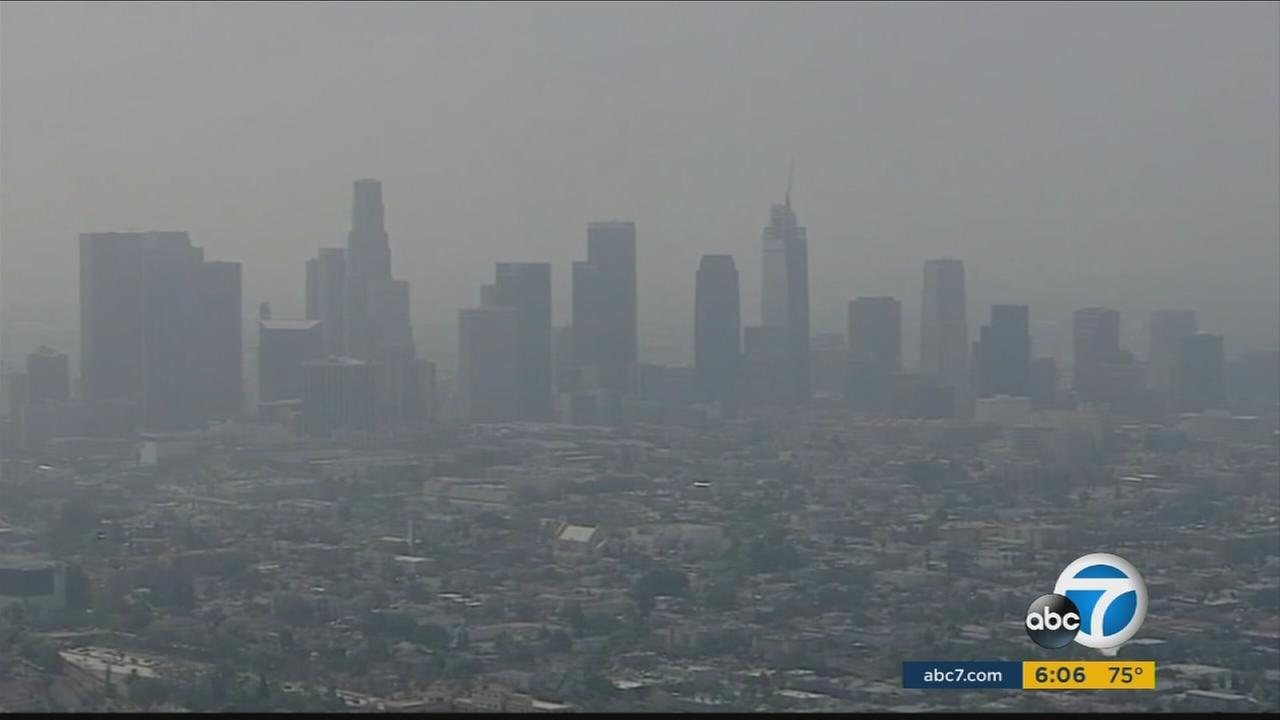 Smog surrounds the downtown Los Angeles skyline.