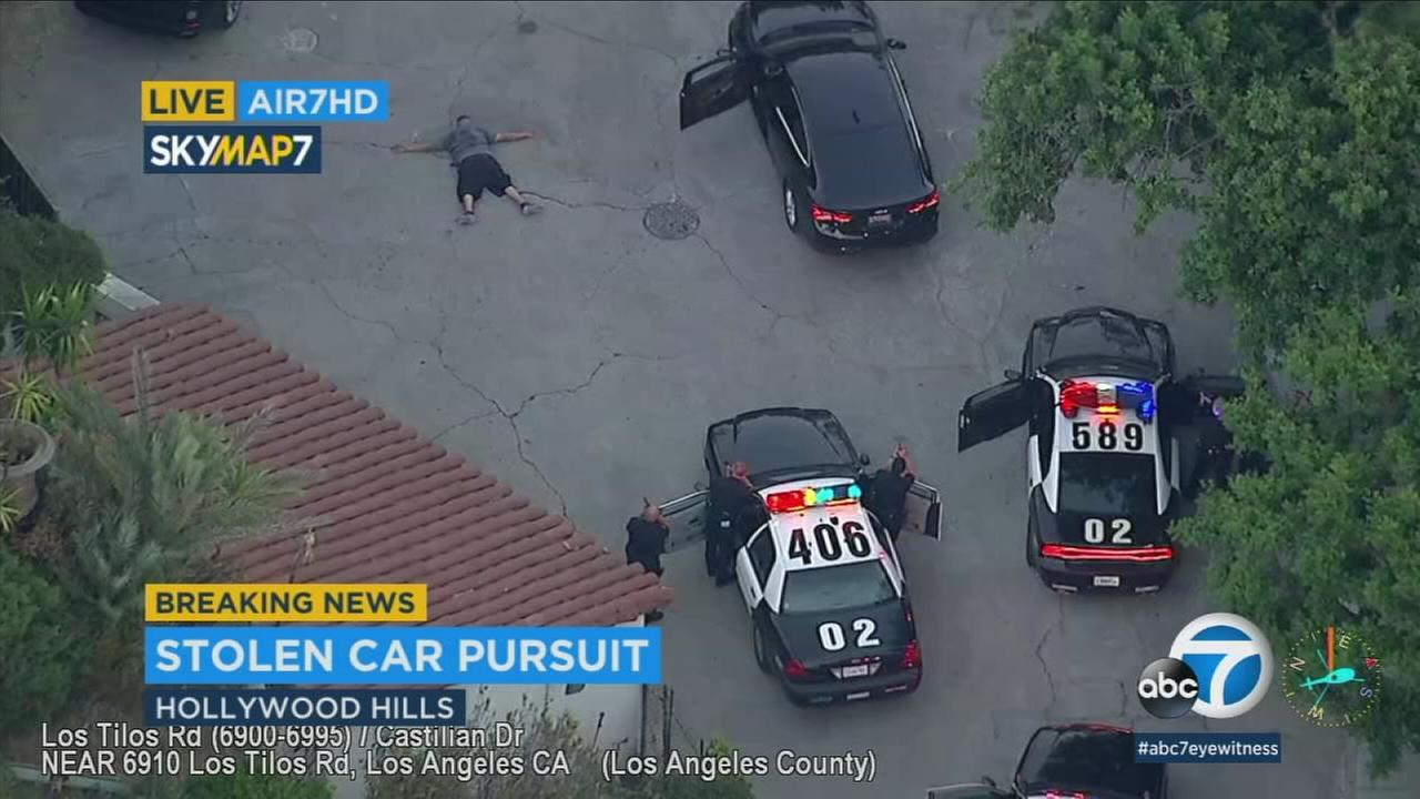 A driver has surrendered after Los Angeles police chased the man suspected of vehicle theft through the Hollywood area on a busy Friday night.