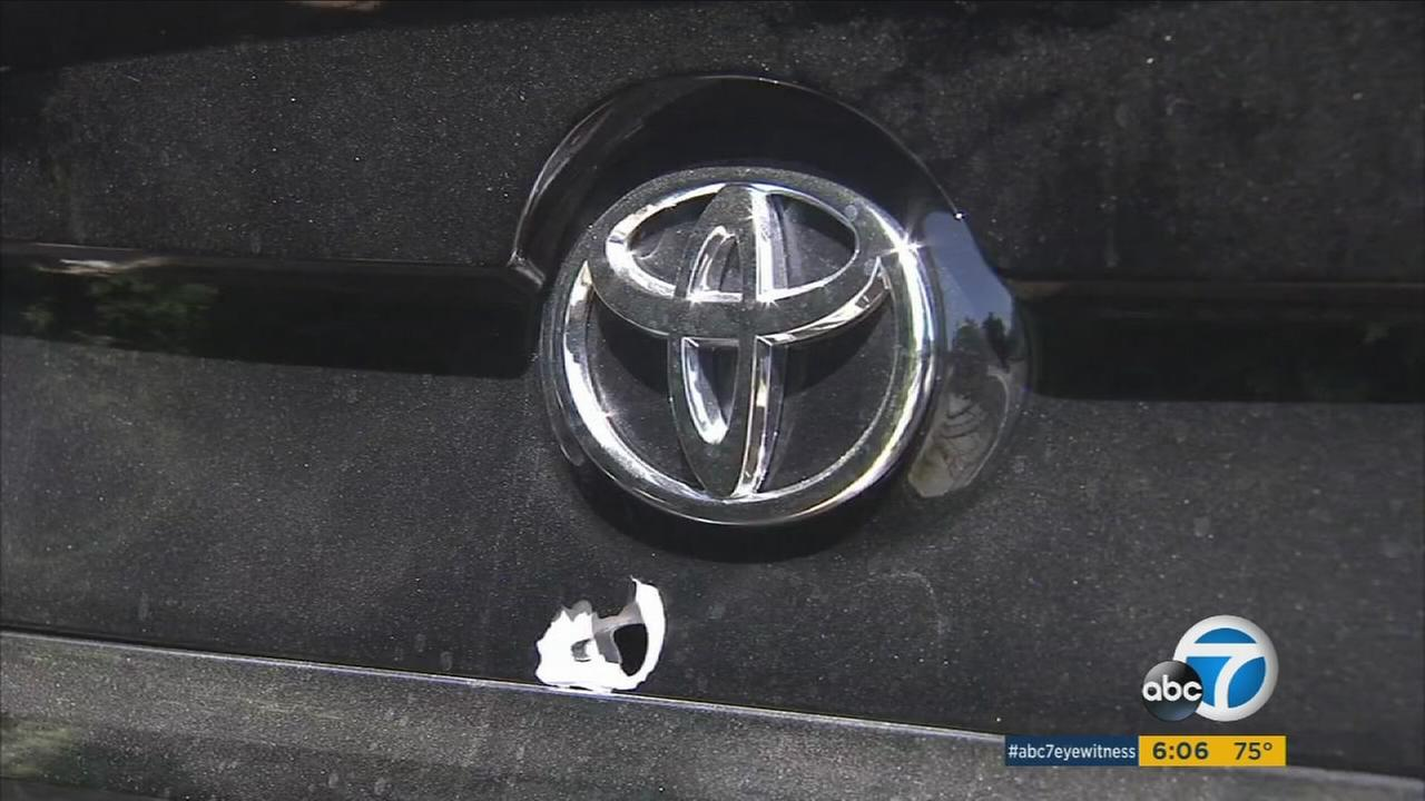 A bullet hole is shown near a Toyota symbol on the back of a witnesss car after a shooting broke out at a Studio City bar in Saturday, Aug. 19, 2017.
