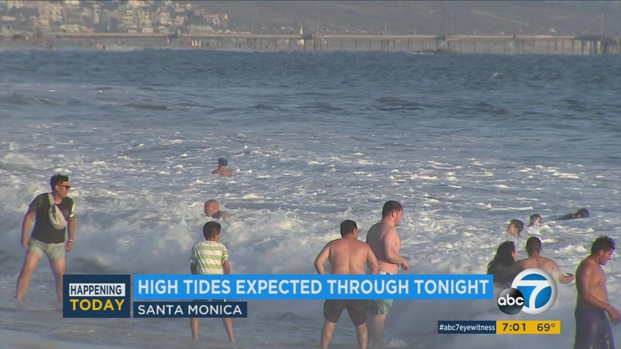 An undated photo of beachgoers at Santa Monica State Beach amid a high tide warning on Sunday, Aug. 20, 2017.