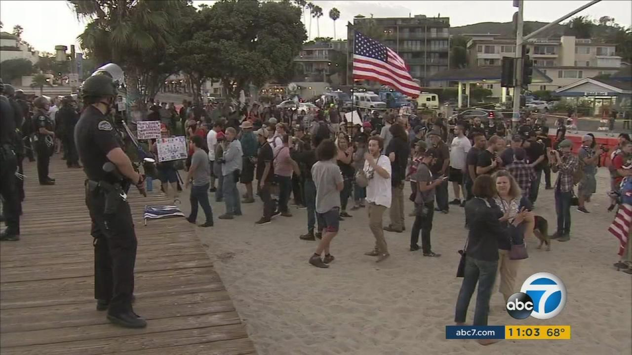 Three people were arrested during a right-wing rally and a counter-demonstration Sunday evening in Laguna Beach, police said.