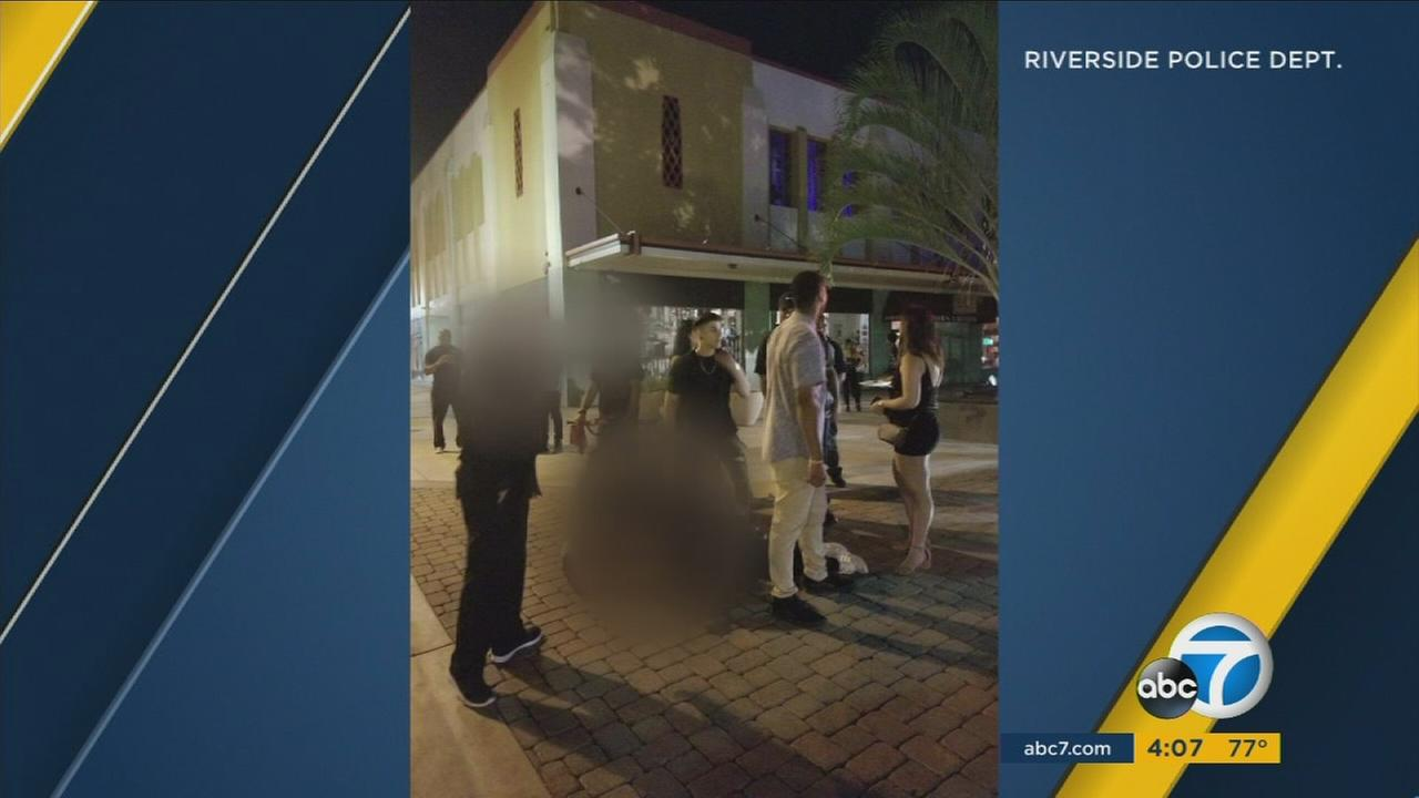 The search continues for two men suspected in the death of a Good Samaritan trying to break up a fight outside of a bar in Riverside.