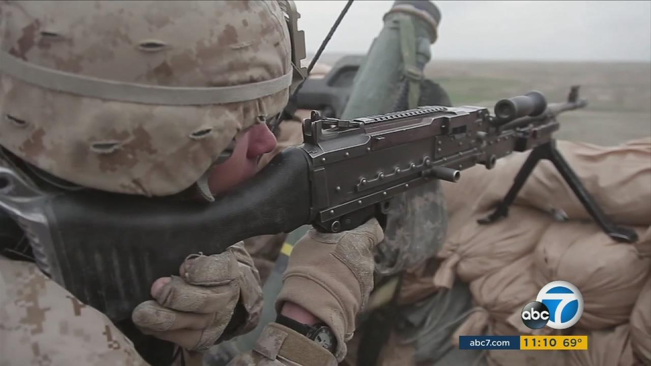 A soldier shooting a gun is shown in footage from the documentary Soy Nero.