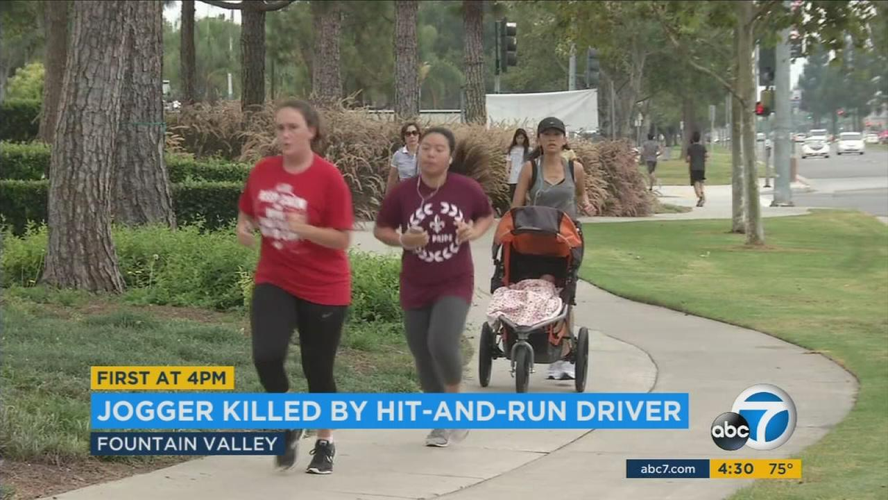 Joggers and people walk around Mile Square Park not far from where a man was killed in a hit-and-run crash in Fountain Valley.