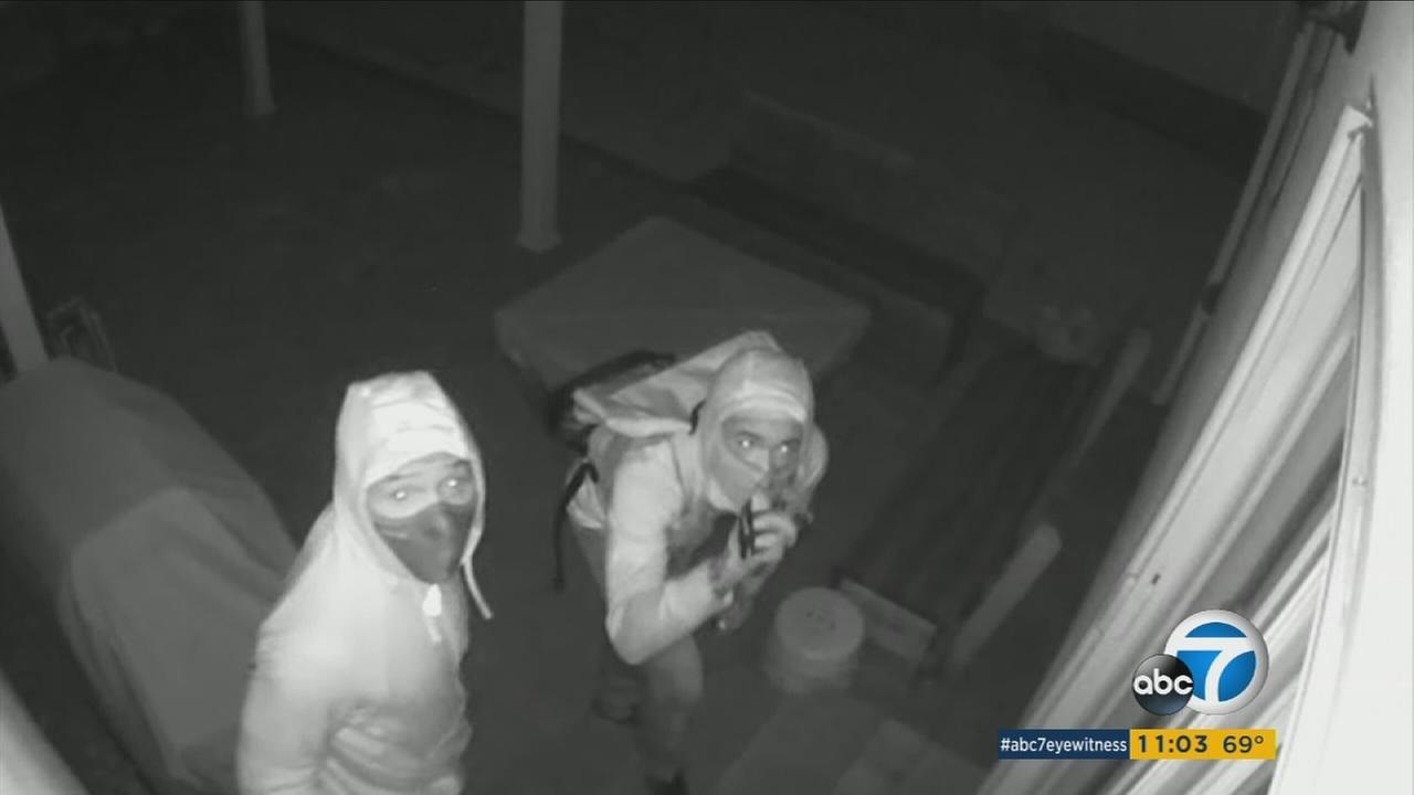 Burglary suspects spot a camera at an Encino home before they cut the power.