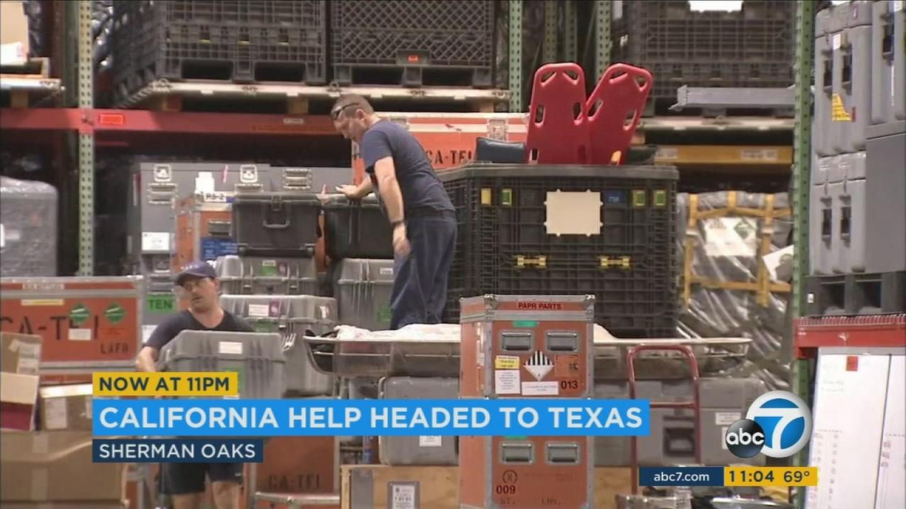 Firefighters put together supplies and gear as they get ready to head to help people who have suffered from the devastating storm in Texas.