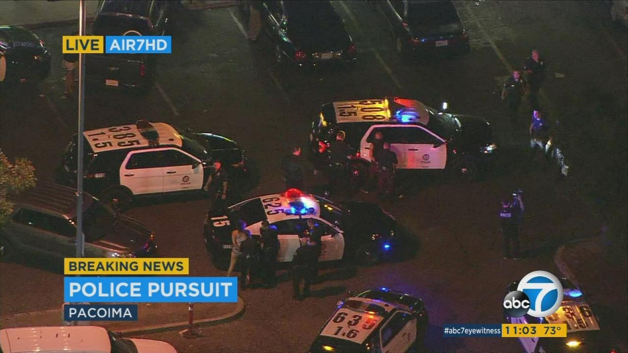 Los Angeles police pursued a possible stolen vehicle at high speeds on surface streets through North Hollywood Monday before taking the driver into custody at a Pacoima grocery store.