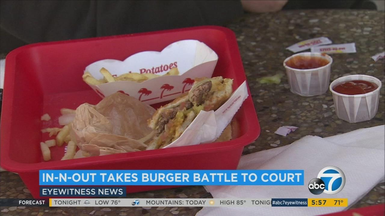 Its a full-on battle of the burgers. In-N-Out is taking fast-food rival Smashburger to court over a stacked-patty creation.