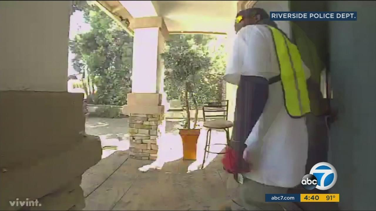 A suspect in a yellow construction-type vest is shown during a home-invasion robbery in Riverside on Tuesday, Aug. 29, 2017.