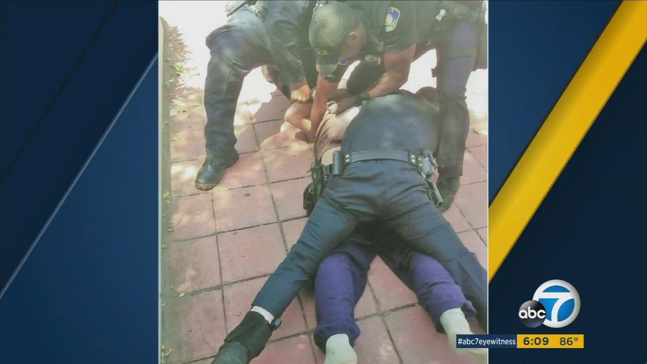 Photos show Whittier police on top of Jonathan Salcido, a man with a mental illness who died during the struggle.