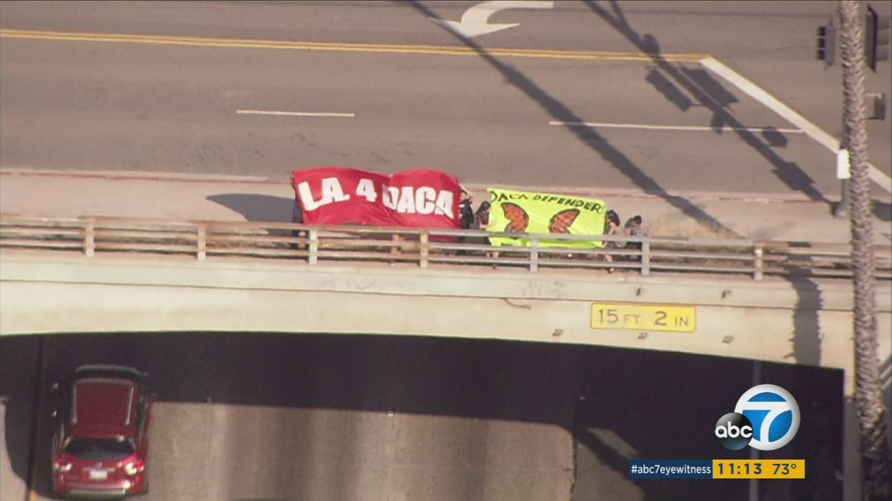 Activists held signs to bring awareness to the issue that DACA could be removed depending on a decision from President Donald Trump.