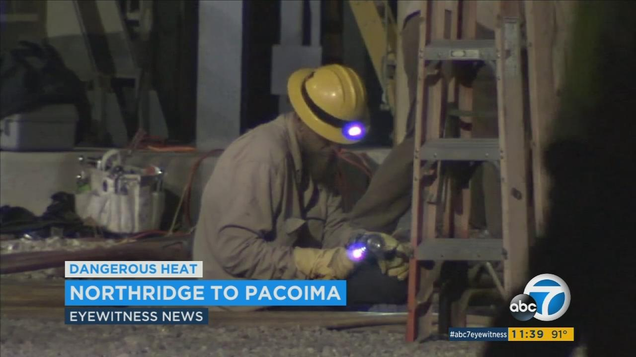 Utility crews worked Tuesday night to restore power after an outage in the San Fernando Valley amid the heat wave.