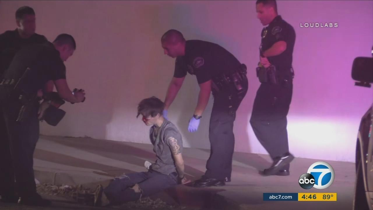 Police speak to a man who allegedly tried to pull a gun on an MMA instructor at a Burbank studio.