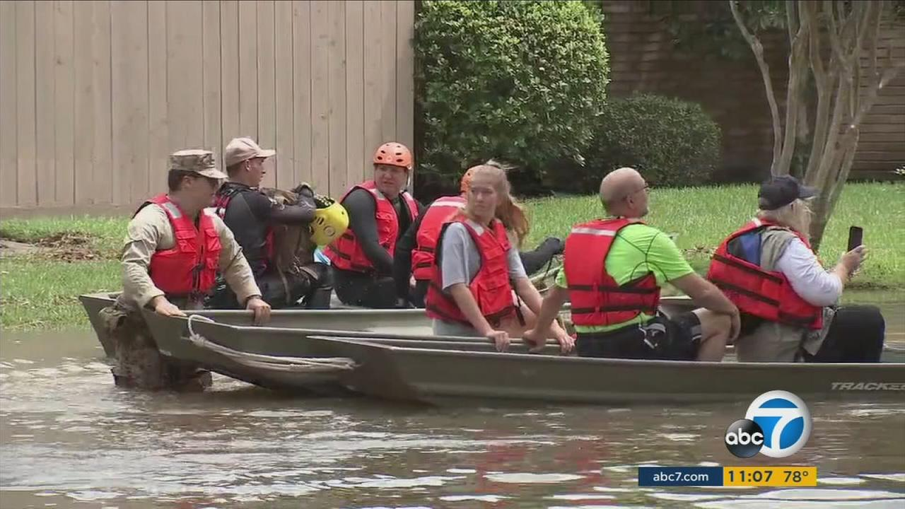 Rescue crews use boats to get people out of flooded areas in southeast Texas amid the chaos of Hurricane Harvey.