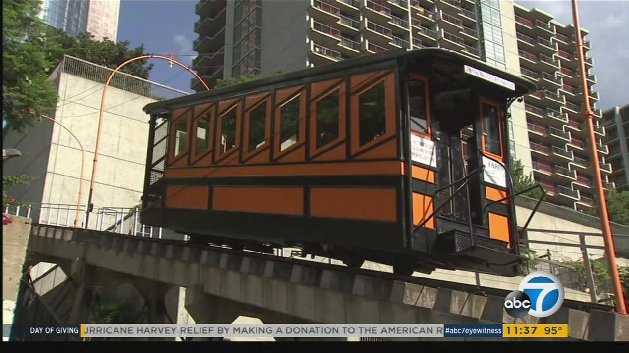 Angels Flight, known as the shortest railway in the world, reopen amid fanfare in downtown Los Angeles on Thursday, Aug. 31, 2017, after a four-year hiatus.