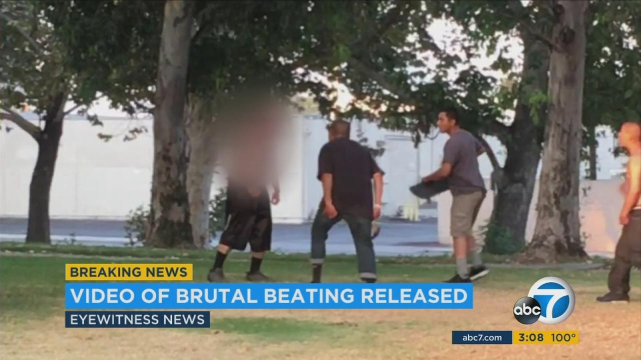 Two men are shown beating a Santa Ana man with a skateboard and hammer at a park in the city.