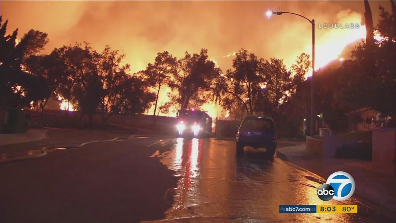 The 5,000-acre La Tuna fire rages above a residential street on Sept. 2, 2017.