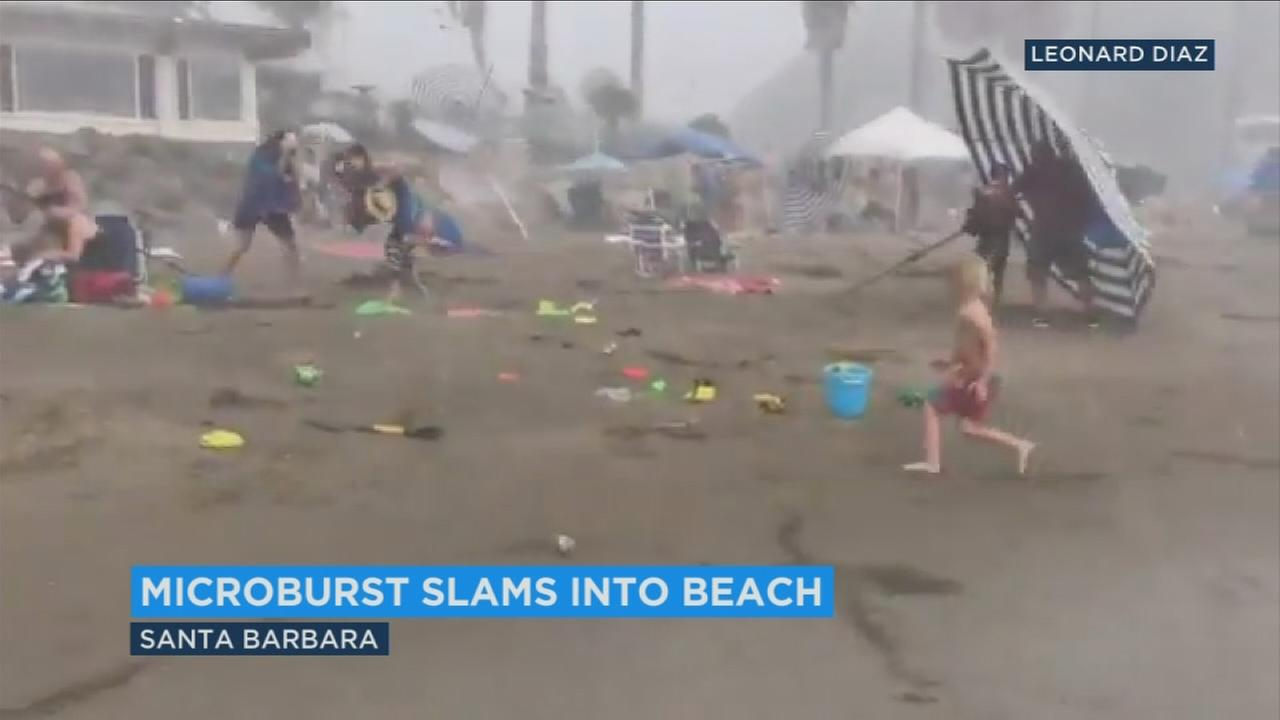 Beachgoers scrambled to find shelter as umbrellas and chairs went flying when a sudden storm event hit Santa Barbara on Sunday, Sept. 3, 2017.