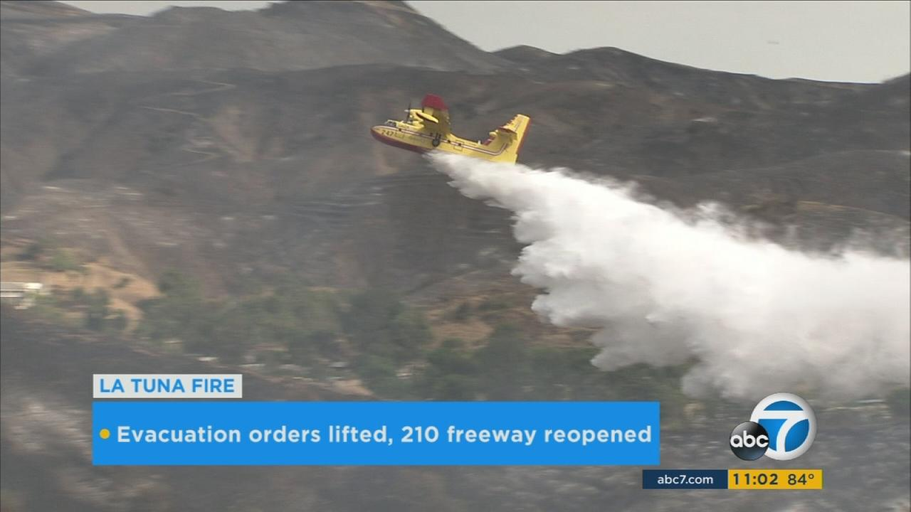 Firefighters drop water on the La Tuna Fire on Sunday, Aug. 4, 2017.