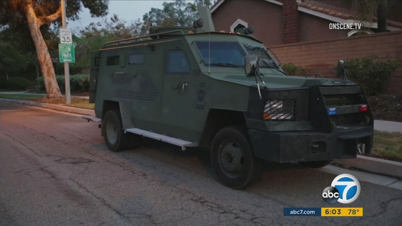 A SWAT vehicle is shown in front of a Rancho Cucamonga home, where a burglary suspect opened fire on a homeowner who then returned fire.