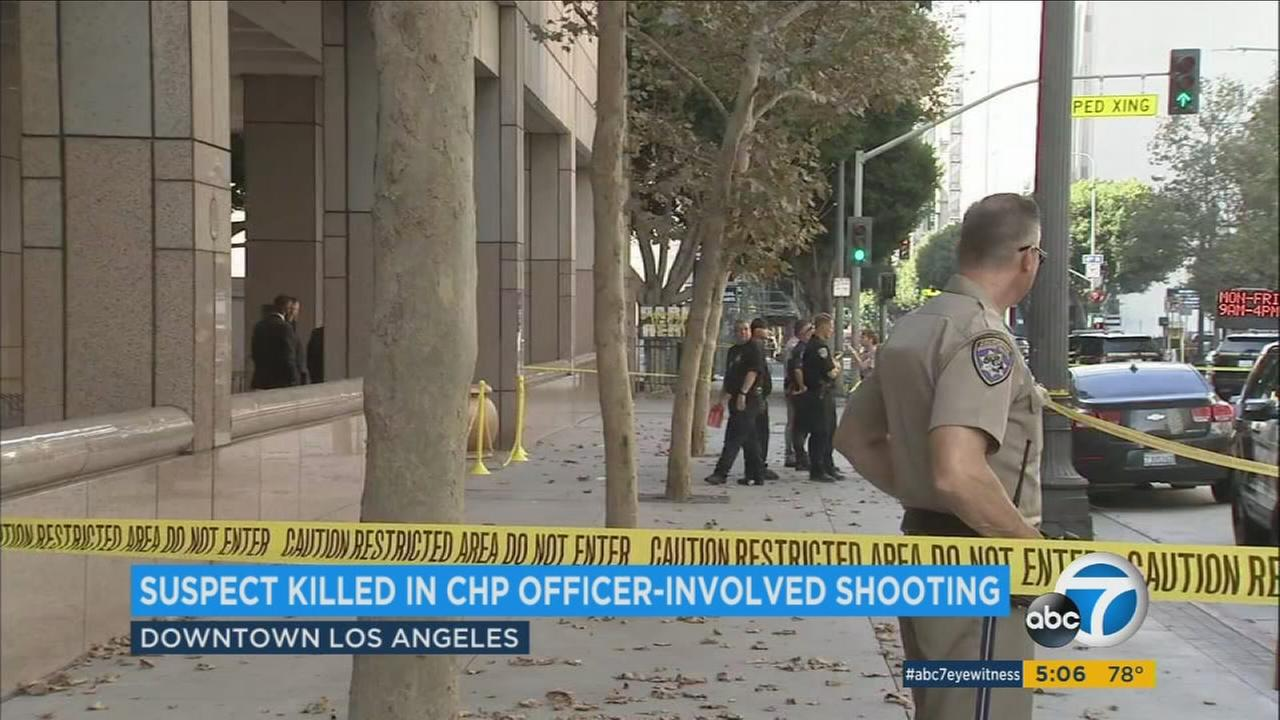 A suspect was fatally shot by a CHP officer after the man, with his hands hidden, took an aggressive shooting stance inside a downtown L.A. building Wednesday, authorities said.