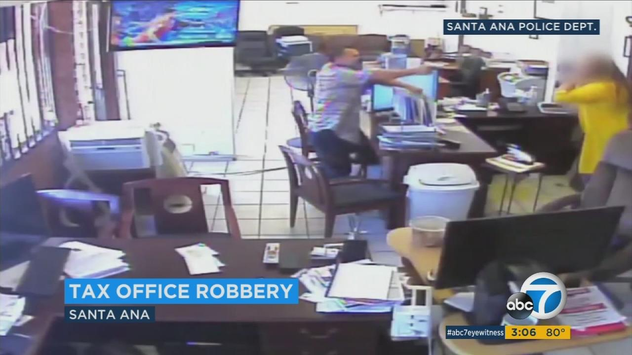 Surveillance video captured a violent robbery at an income-tax services office in Santa Ana, where a man pistol-whipped a female employee.