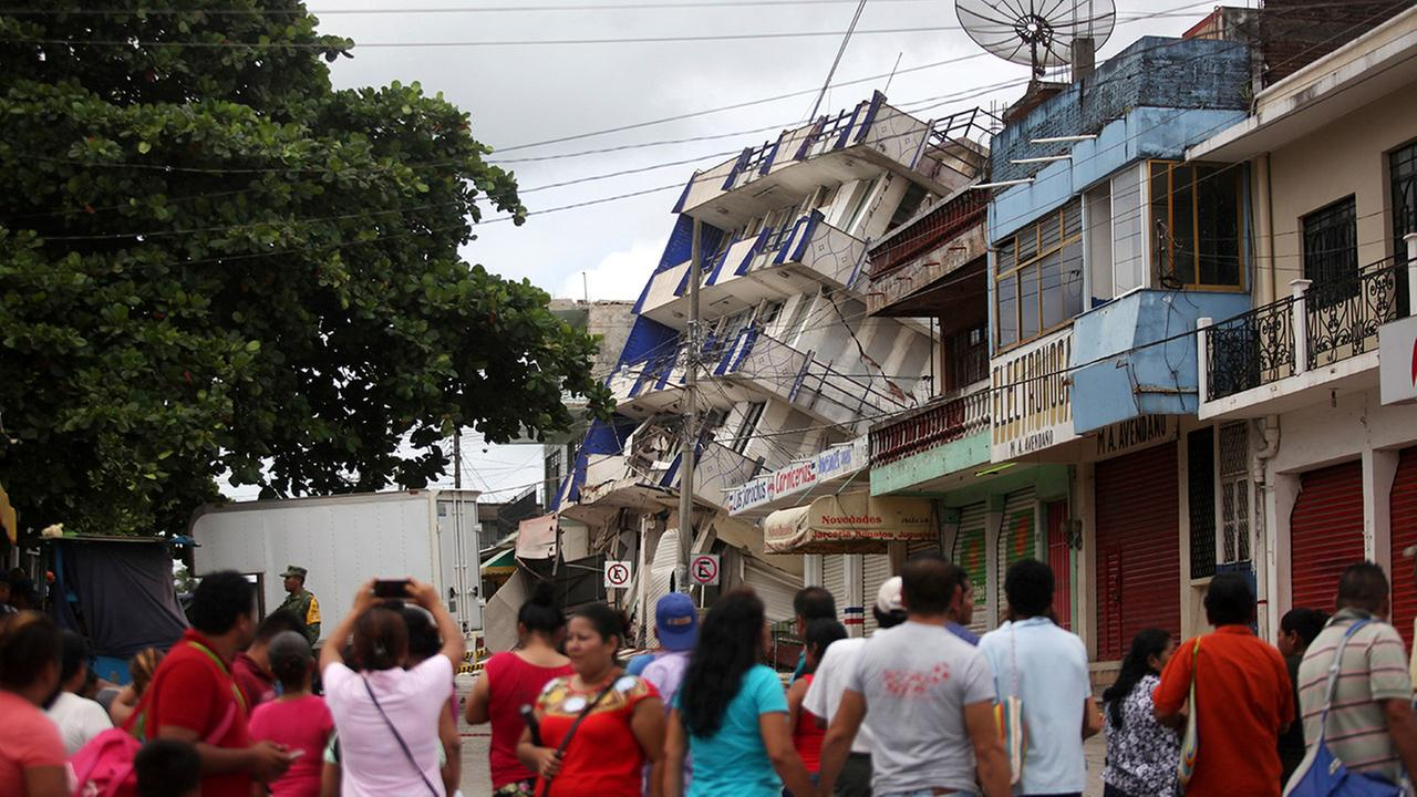 Residents look at a partially collapsed hotel in Matias Romero, Oaxaca state, Mexico, Friday, Sept. 8, 2017.