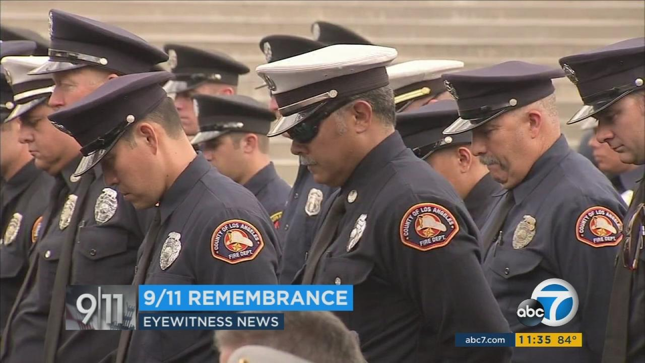 LAFD members bow their heads in remembrance of 9/11 victims during a ceremony on Monday, Sept. 11, 2017.