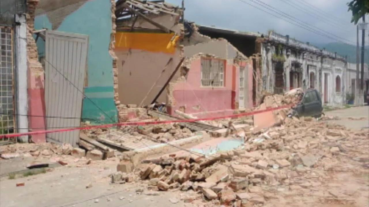 A damaged building in Oaxaca, Mexico, is shown.