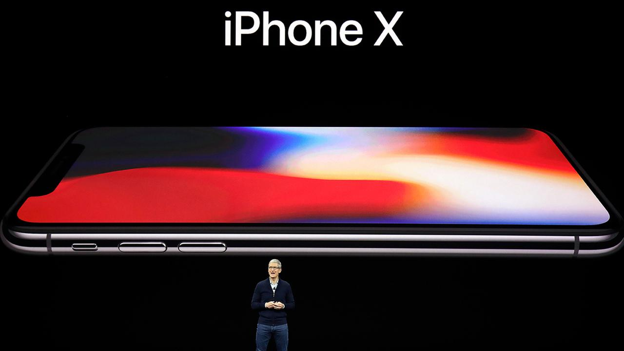 Apple CEO Tim Cook announces the new iPhone X at the Steve Jobs Theater on the new Apple campus, Tuesday, Sept. 12, 2017, in Cupertino, Calif.