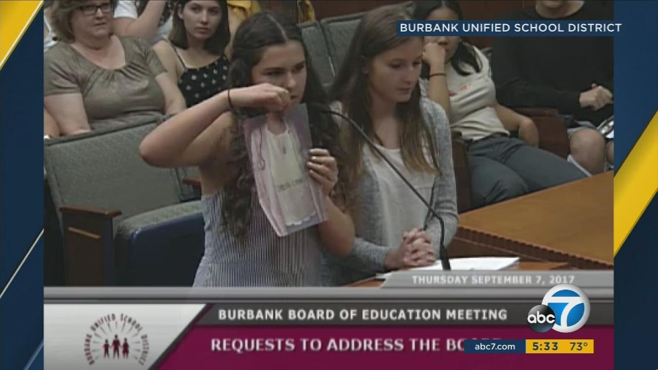 Two students show the clothes they wore that were considered dress code violations at one of the high schools in Burbank.