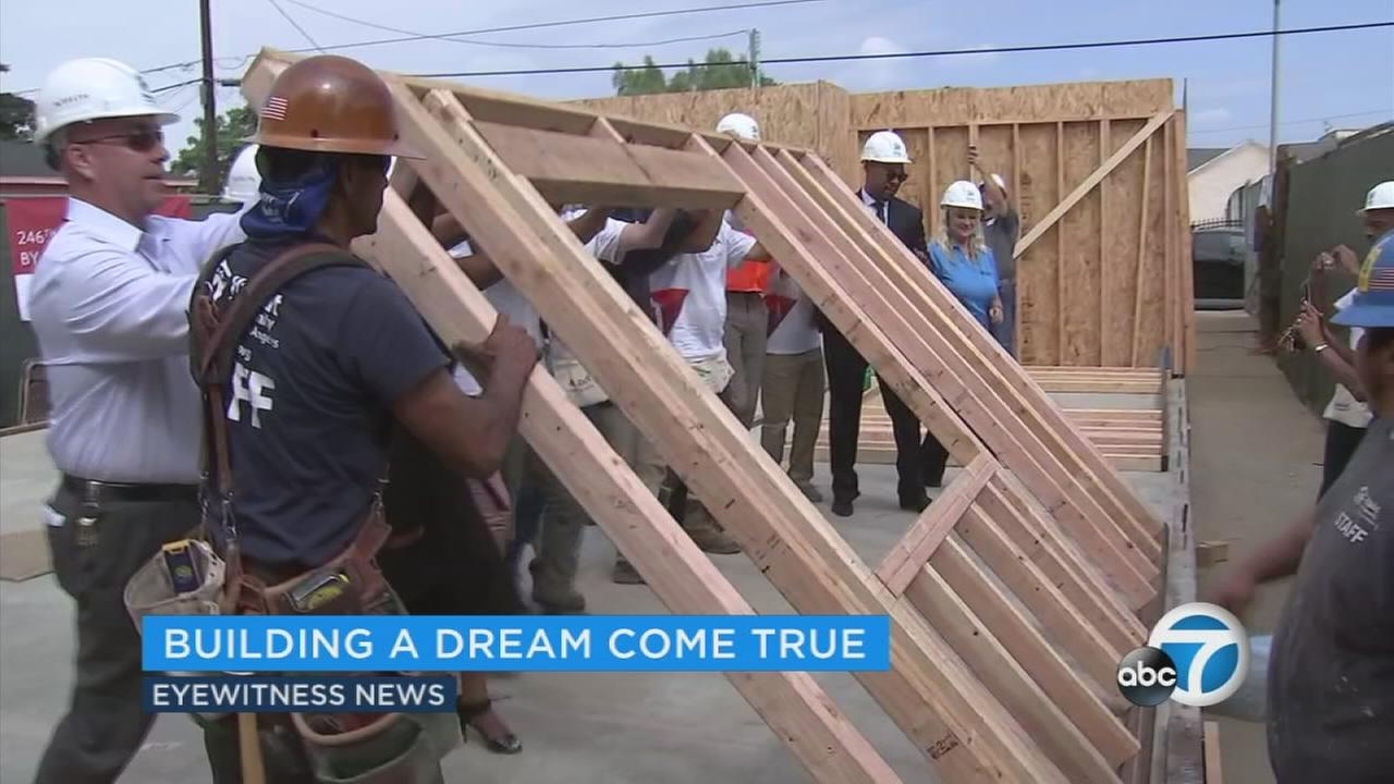 There was sawing and hammering and raising walls as the Los Angeles chapter of Habitat for Humanity got going on its 800th house Wednesday.