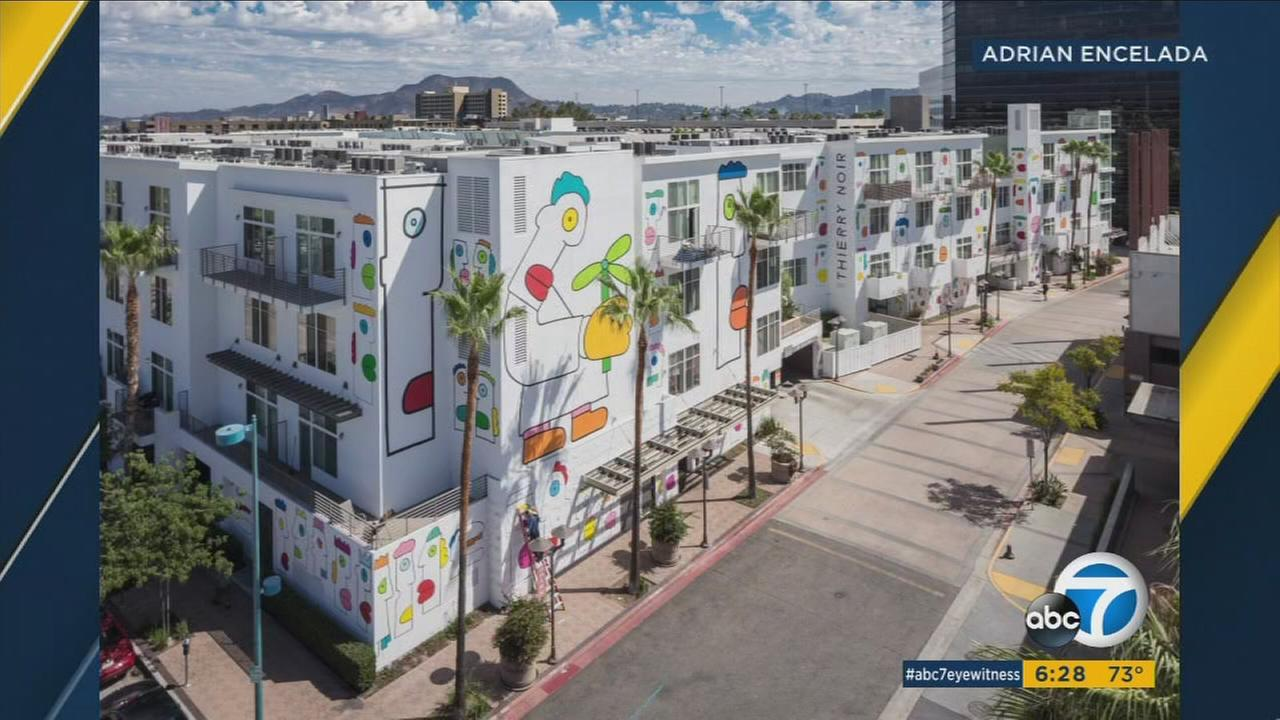 A North Hollywood apartment complex situated in the arts district just got a makeover by French artist, Thierry Noir, known for his iconic work along the Berlin Wall.