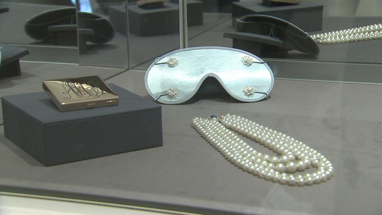 Eye sleep covers, pearls and a compact with Audrey Hepburns initials are shown on display in Beverly Hills.