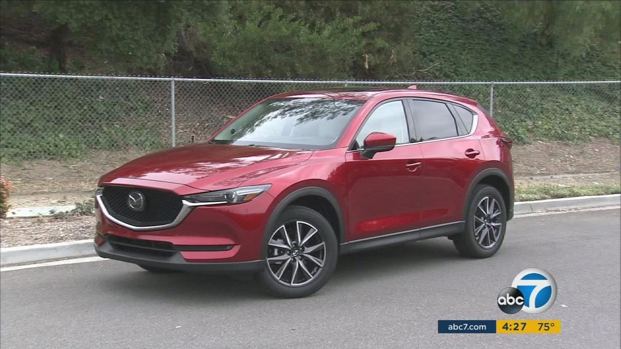 A Mazda CX-5 is shown in a display photo.