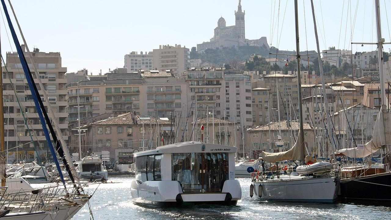A solar-powered small ferry boat crosses the old port of Marseille, southern France, Tuesday, Feb. 2, 2010.