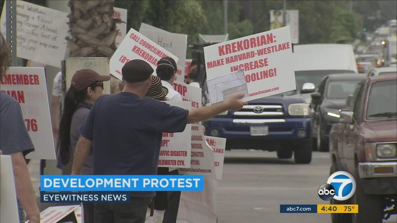 Holding signs and chanting, protesters rallied at the corner of Coldwater Canyon and Ventura Boulevard in Studio City to voice their concerns about what they call a potential traffic nightmare.