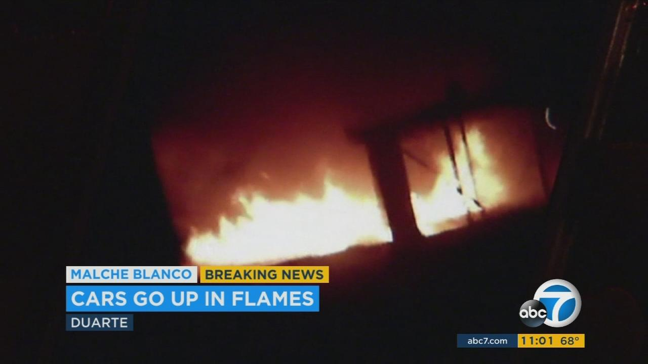 Four people were injured and 11 vehicles were burned in a carport fire in Duarte Monday night, officials said.