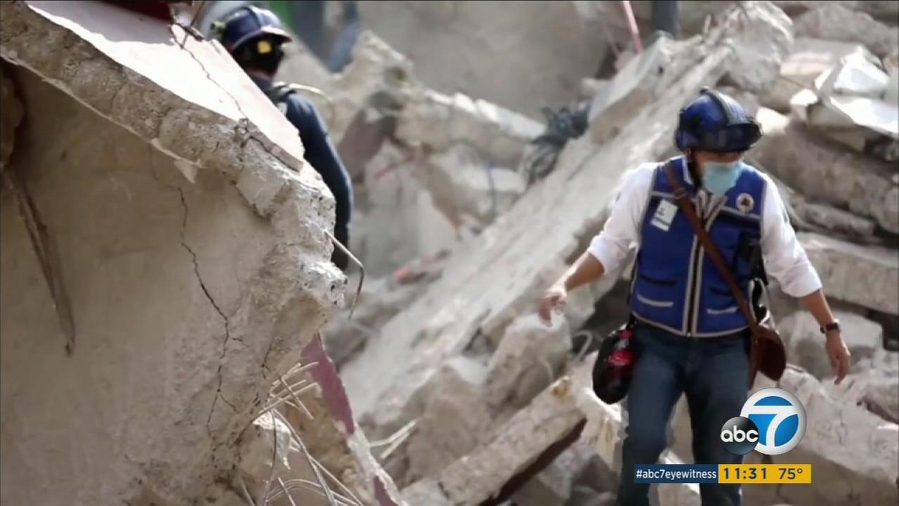 A person walks through the rubble of a building in Mexico after a 7.1 temblor killed hundreds near Mexico City on Tuesday, Sept. 19, 2017.